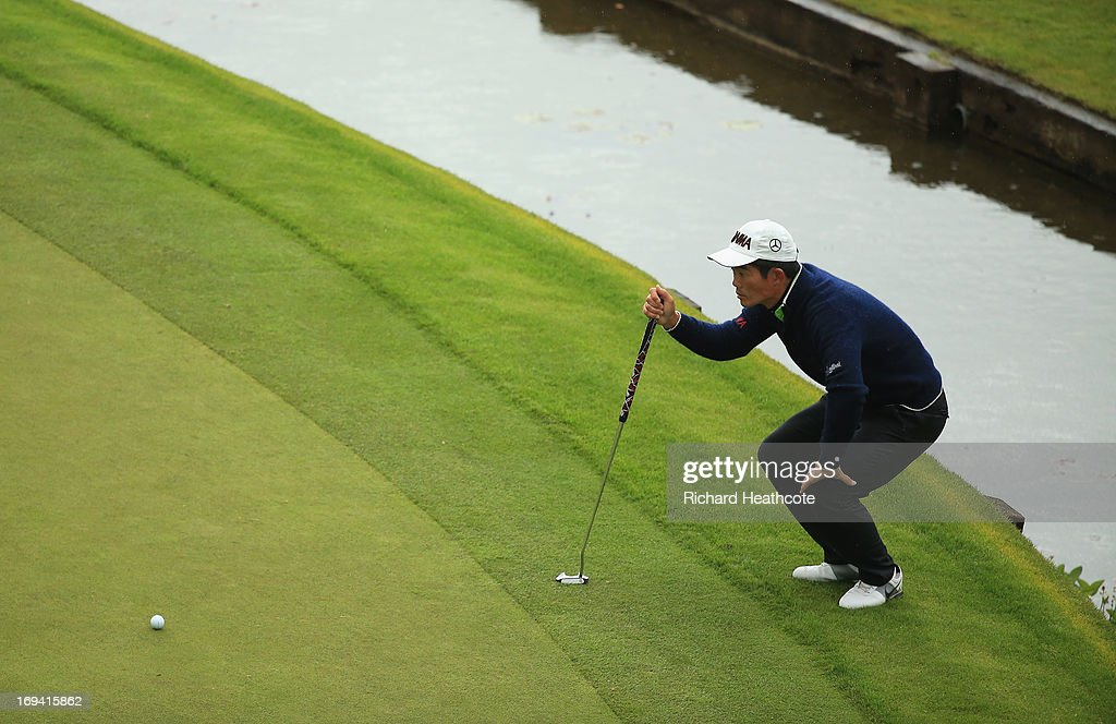 Liang Wen-Chong of China lines up a putt on the 18th green during the second round of the BMW PGA Championship on the West Course at Wentworth on May 24, 2013 in Virginia Water, England.