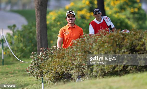 Liang Wenchong of China looks for his lost ball during day three of the Avantha Masters at Jaypee Greens Golf Club on March 16 2013 in Delhi India