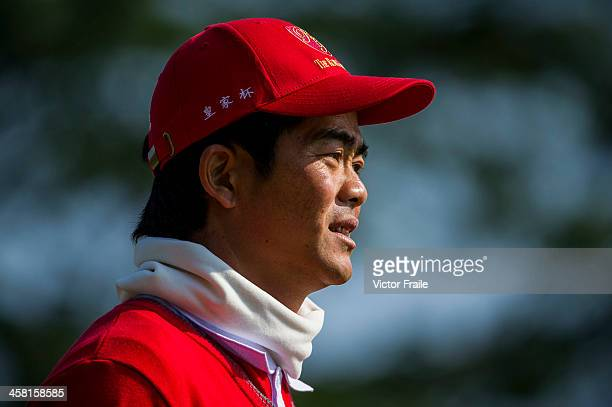 Liang Wenchong of China looks on at the 3rd green during the Royal Trophy Europe vs Asia Championship at the Dragon Lake Golf Club on December 20...