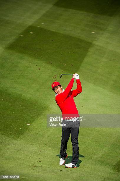 Liang Wenchong of China plays a shot on the 3rd hole during the Royal Trophy Europe vs Asia Championship at the Dragon Lake Golf Club on December 20...