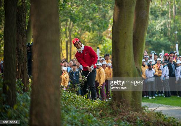 Liang Wenchong of China plays his second shot at the 1st hole during the Royal Trophy Europe vs Asia Championship at the Dragon Lake Golf Club on...