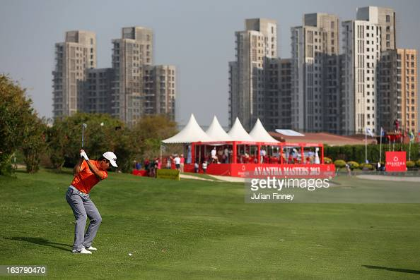 Liang Wenchong of China plays his second shot to the 18th green during day three of the Avantha Masters at Jaypee Greens Golf Club on March 16 2013...