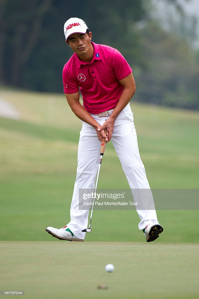 Liang Wenchong of China reacts to a missed putt during round one of the 2014 Venetian Macau Open on October 23, 2014, in Macau, China.