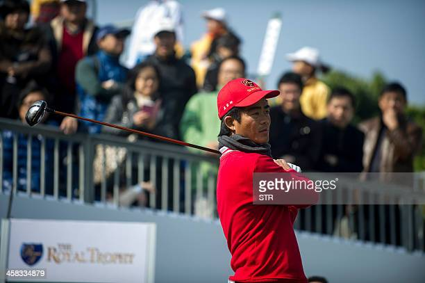 Liang Wenchong of China tees off as he partners Wu Ashun to half with the European team's David Howell and Marc Warren on the secondday of the...