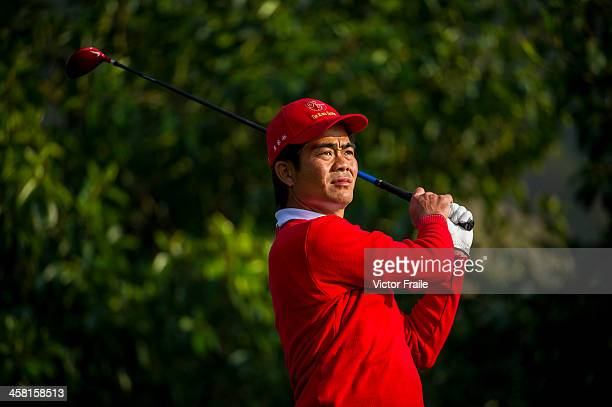 Liang Wenchong of China tees off at the 16th hole during the Royal Trophy Europe vs Asia Championship at the Dragon Lake Golf Club on December 20...
