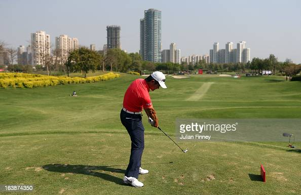 Liang Wenchong of China tees off on the 17th hole during day four of the Avantha Masters at Jaypee Greens Golf Club on March 17 2013 in Delhi India