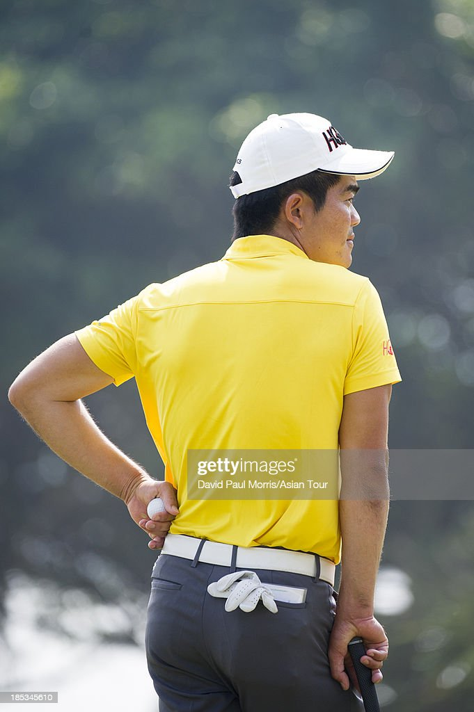 Liang Wen-chong of China waits to putt on the 18th green during round three of the Venetian Macau Open on Oct. 19, 2013 at the Macau Golf & Country Club in Macau. The Asian Tour tournament offers a record US$ 800,000 prize money which goes through October 20.