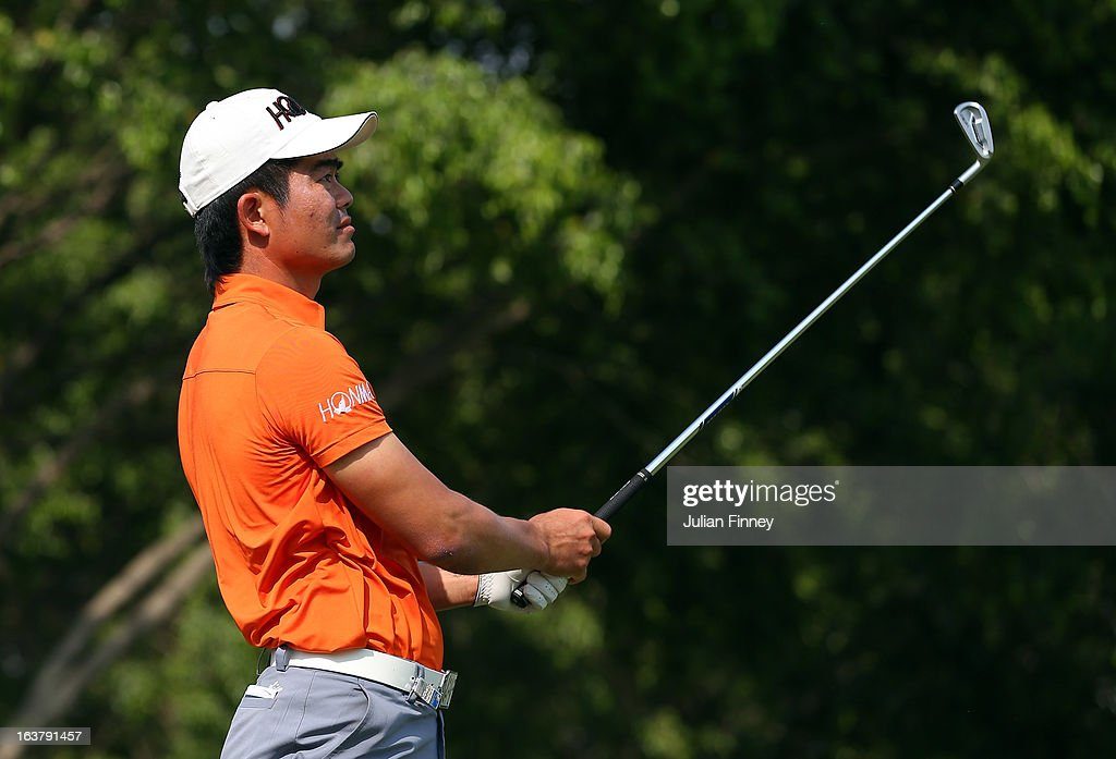 Liang Wenchong of China watches his shot during day three of the Avantha Masters at Jaypee Greens Golf Club on March 16, 2013 in Delhi, India.