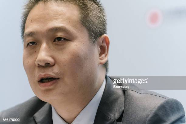 Liang Xiaodong cochief executive officer and executive director of China Literature Ltd speaks during a news conference in Hong Kong China on...