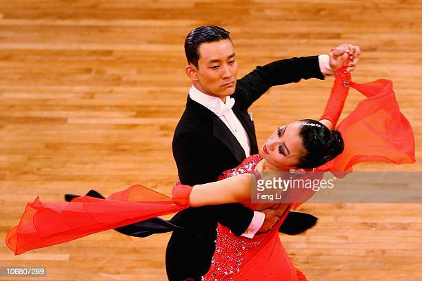 Liang Yu Jie and Shen Hong of China compete in the the StandardTango of the Dance Sports at the Zengcheng Gymnasium during day one of the 16th Asian...
