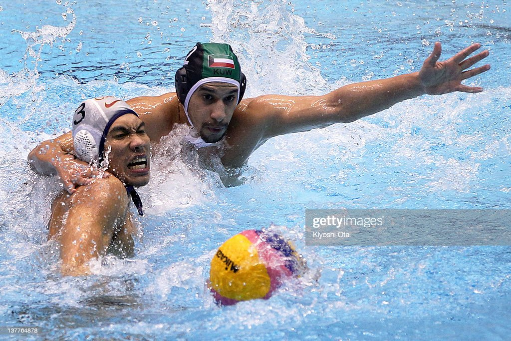 Liang Zhongxing (L) of China and Jasem Alsafran of Kuwait compete for the ball during the Asian Water Polo Championships 2012 match between China and Kuwait at Chiba International General Swimming Center on January 26, 2012 in Narashino, Japan.