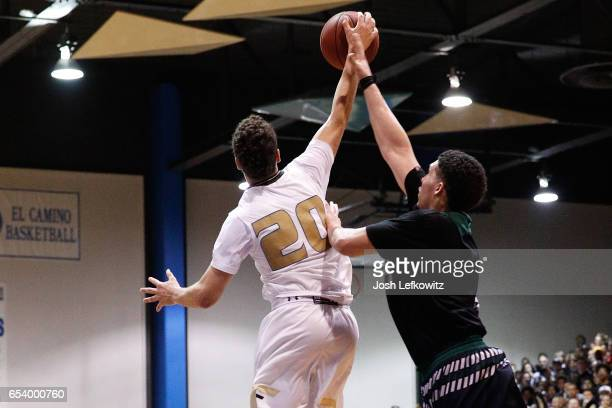 LiAngelo Ball of Chino Hills High School and Jordan Schakel of Bishop Montgomery High School fight for possession of the ball during the game between...