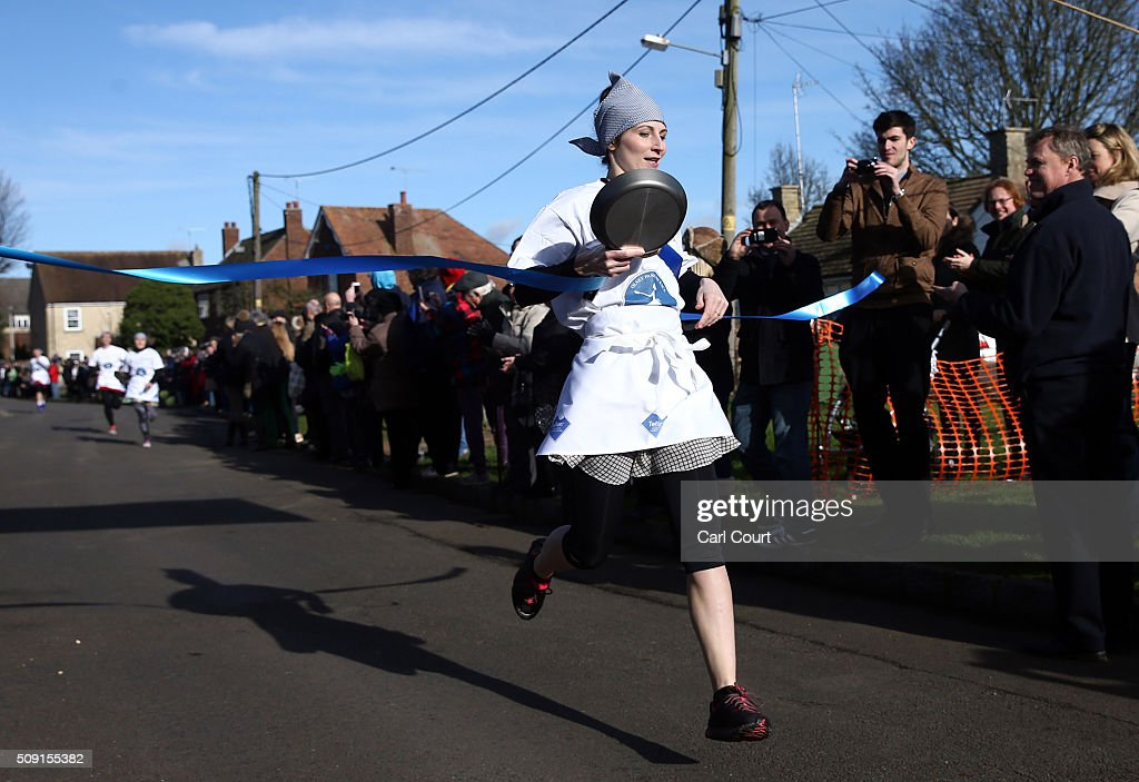 Lianne Fisher crosses the finish line after running a record time of 55.02 seconds in the annual Shrove Tuesday trans-Atlantic pancake race on February 9, 2016 in Olney, England. On Shrove Tuesday every year the ladies of Olney, Buckinghamshire compete in a Pancake Race, a tradition which dates back to 1445. Children from Olney schools also take part in their own races. Olney competes every year against the women of Liberal, Kansas, USA in a friendly race dating back to 1950.