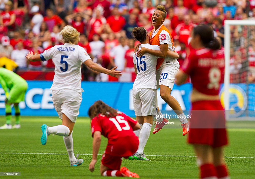 Lianne Sanderson #20 of England celebrates her teams win with teammate Casey Stoney #15 after defeating Canada during the FIFA Women's World Cup Canada 2015 Quarter Final match between England and Canada June 27, 2015 at BC Place Stadium in Vancouver, British Columbia, Canada.