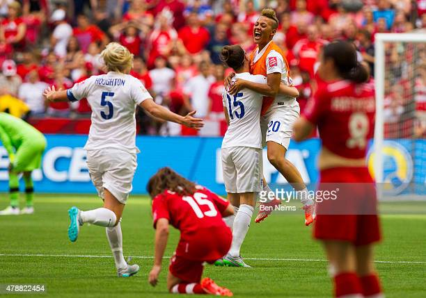Lianne Sanderson of England celebrates her teams win with teammate Casey Stoney after defeating Canada during the FIFA Women's World Cup Canada 2015...