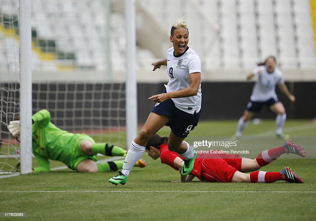 Lianne Sanderson (C) of England celebrates scoring a goal during the Cyprus Cup match between England and Canada at GSP stadium on March 10, 2014 in Nicosia, Cyprus.