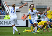 Lianne Sanderson of England celebrates scoring during the Women's International Friendly match between England and Sweden at Victoria Park on August...