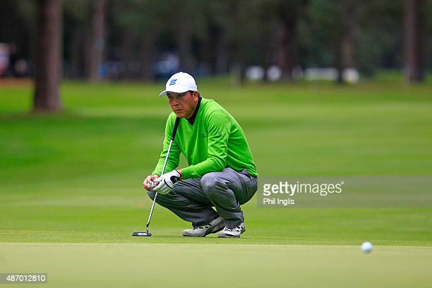 Lianwei Zhang of China in action on the 18th green during the second round of the Travis Perkins Masters played at the Duke's Course Woburn Golf Club...