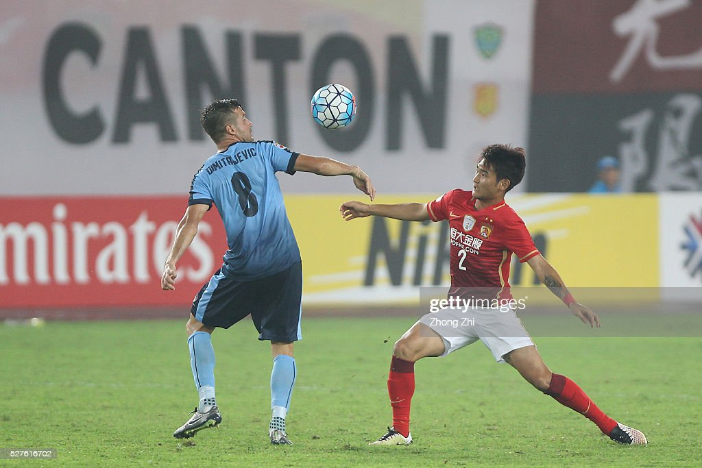Liao Lisheng of Guangzhou Evergrande in action against Milos Dimitrijevic of Sydney FC during the AFC Asian Champions League match between Guangzhou Evergrande FC and Sydney FC at Tianhe Stadium on May 3, 2016 in Guangzhou, China.