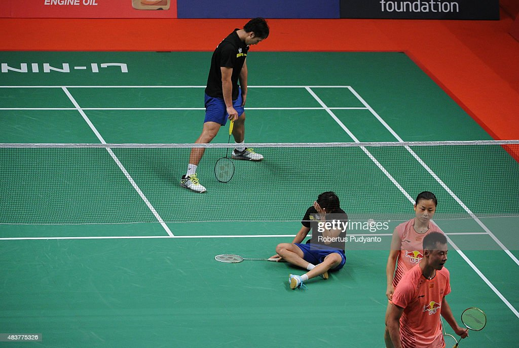 Liao Min Chun and Chen Hsiao Huan of Taipei (black) react after defeated by <a gi-track='captionPersonalityLinkClicked' href=/galleries/search?phrase=Xu+Chen+-+Badminton+Player&family=editorial&specificpeople=9612195 ng-click='$event.stopPropagation()'>Xu Chen</a> and <a gi-track='captionPersonalityLinkClicked' href=/galleries/search?phrase=Ma+Jin&family=editorial&specificpeople=5747194 ng-click='$event.stopPropagation()'>Ma Jin</a> of China (orange) in the 2015 Total BWF World Championship at Istora Senayan on August 13, 2015 in Jakarta, Indonesia.