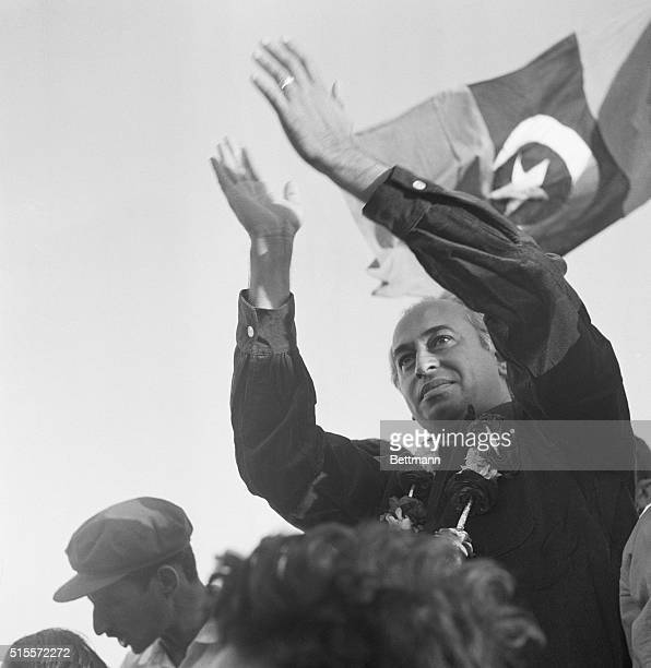 Zulfikar Ali Bhutto a former Foreign minister of Pakistan waves to a crowd assembled to hear him speak in Liaquatabad a Karichi suburb Mar...