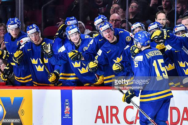 Lias Andersson of Team Sweden celebrates his second period goal with teammates on the bench during the 2017 IIHF World Junior Championship...