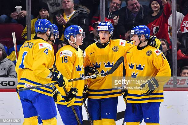 Lias Andersson of Team Sweden celebrates his third period goal with teammates during the 2017 IIHF World Junior Championship quarterfinal game...