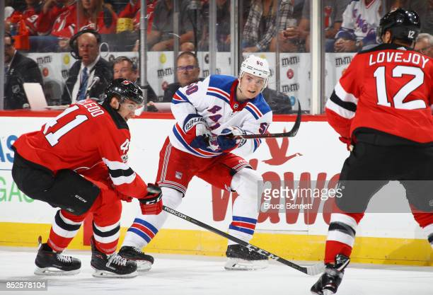 Lias Andersson of the New York Rangers scales the puck into the New Jersey Devils end during the first period at the Prudential Center on September...