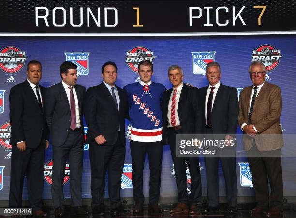 Lias Andersson seventh overall pick of the New York Rangers poses for a photo onstage with the Rangers draft team during Round One of the 2017 NHL...