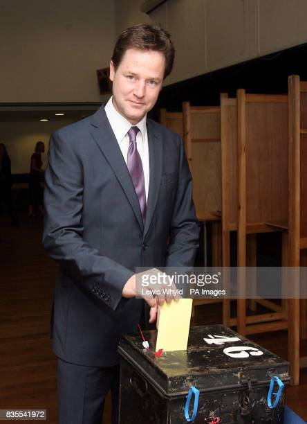 Lib Dem leader Nick Clegg casts his vote in the European election at a polling station at Dryburgh Hall in Putney London