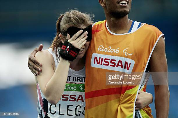 Libby Clegg and Chris Clarke of Great Britain celebrates after winning the women's 100m T11 Semifinals at the Olympic Stadium on Day 2 of the Rio...
