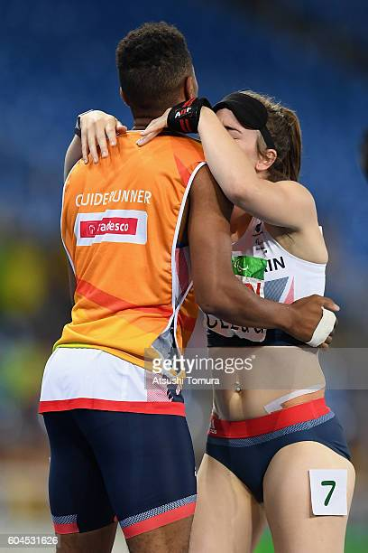 Libby Clegg of Great Britain celebrates winning the gold medal with her giude Chris Clarke in the Women's 200m T11 final on day 6 of the Rio 2016...