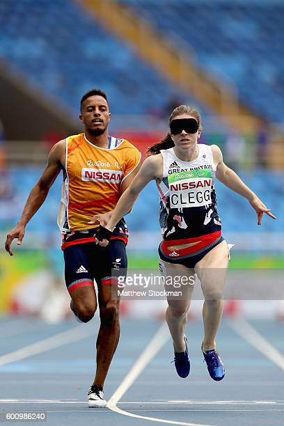 Libby Clegg of Great Britain with guide Chris Clarke competes heat 2 of the 100 meter T11 on day 1 of the Rio 2016 Paralympic Games at Olympic...