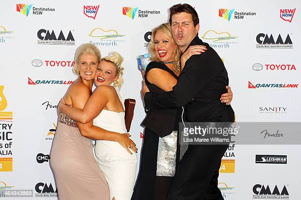 Libby O'Donovan Kathy Harvey Beccy Cole and Adam Harvey play up to photographers at the 42nd Country Music Awards Of Australia on January 25 2014 in...