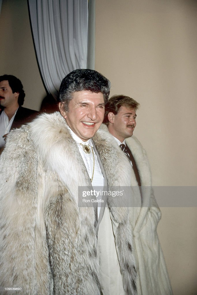 <a gi-track='captionPersonalityLinkClicked' href=/galleries/search?phrase=Liberace+-+Pianist&family=editorial&specificpeople=208688 ng-click='$event.stopPropagation()'>Liberace</a> and Cary James Wyman during Shirley MacLaine's 50th Birthday Party, 1984 at Limelight in New York, New York, United States.