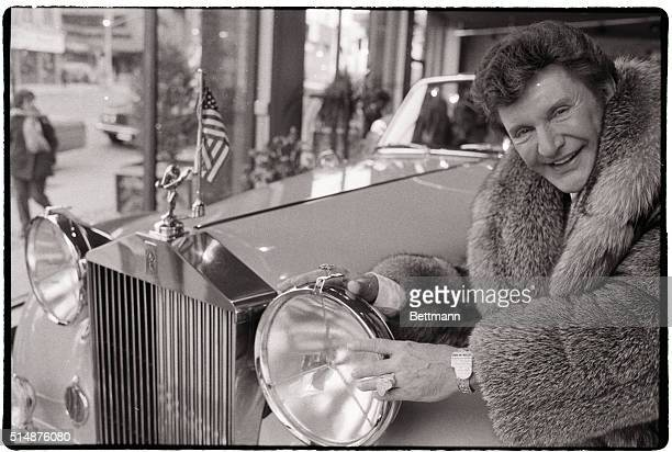 Liberace purrs over his RollsRoyce Silver Cloud which was formerly owned by Mike Todd and thenwife Elizabeth Taylor Todd had helped to design the car...