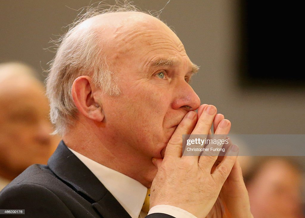 Liberal Democrat business secretary Vince Cable listens to a speaker during the party's spring conference at the ACC on March 14, 2015 in Liverpool, England. Deputy Prime Minister Nick Clegg confirmed today that Mental health services in England will receive £1.25bn in next week's Budget.