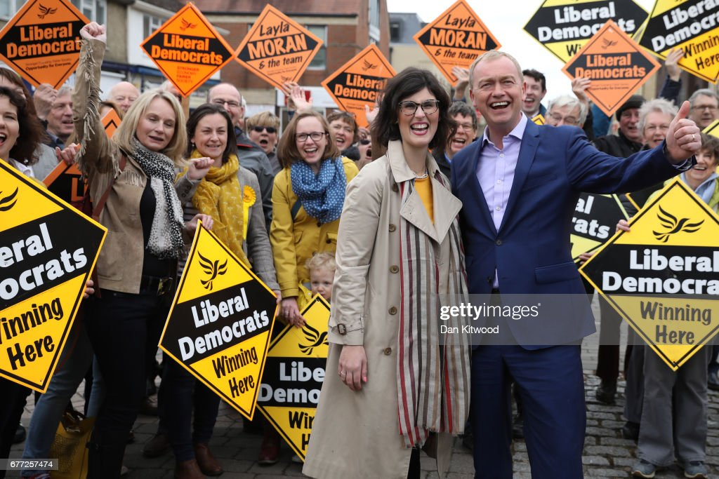 Liberal Democrat candidate for the constituency of Oxford West and Abingdon, Layla Moran (2nd-R) stands with supporters next to Liberal Democrat leader Tim Farron (R) at a campaign event on May 3, 2017 in Kidlington, a village outside of Oxford, England. The country goes back to the polls for the second time in two years as a general election is held on June 8.