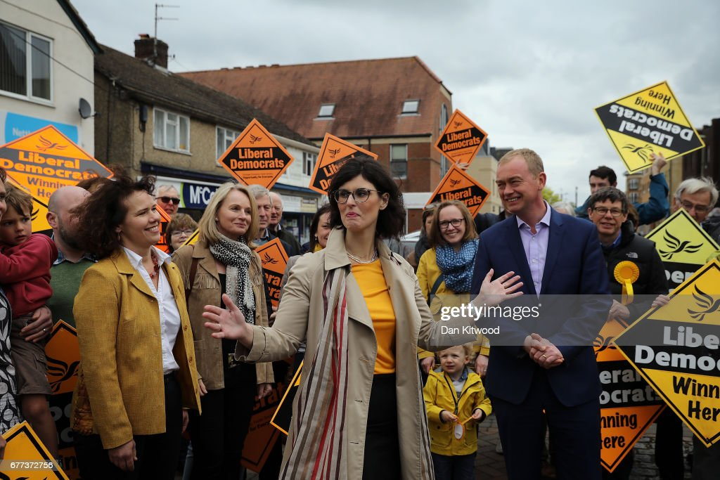 Liberal Democrat candidate for the constituency of Oxford West and Abingdon, Layla Moran (L) speaks to supporters with Liberal Democrat leader Tim Farron at a campaign event on May 3, 2017 in Kidlington, a village outside of Oxford, England. The country goes back to the polls for the second time in two years as a general election is held on June 8.