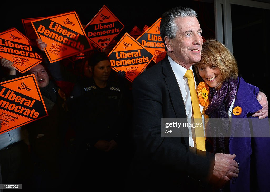 Liberal Democrat candidate Mike Thornton (L) and wife Peta are cheered by supporters as they arrive for the declaration of the Eastleigh by-election in Eastleigh, Hampshire on March 1, 2013. Polls closed in the southern English town of Eastleigh as residents voted for their new member of parliament in a tight contest that threatens serious repercussions for Britain's main parties.
