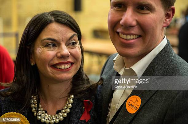 Liberal Democrat candidate Sarah Olney with her husband Ben after winning the Richmond Park byelection at Richmond Upon Thames College on December 2...