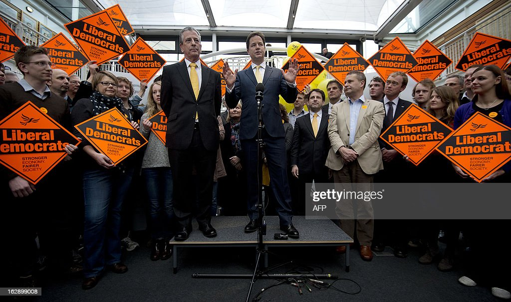 Liberal Democrat leader and Deputy Prime Minister Nick Clegg (R) speaks next to Liberal Democrat new member of parliament for Eastleigh Mike Thornton (L) surrounded by party faithfull as they celebrate their by-election win in Eastleigh, Hampshire, southern England on March 1, 2013. The Liberal Democrats on March 1 hung onto the southern England parliamentary seat of Eastleigh, dealing a heavy blow to Prime Minister David Cameron whose Conservative Party were beaten into third place.