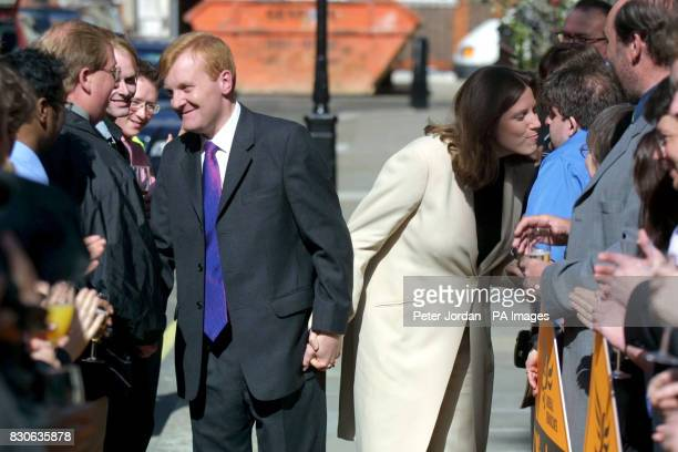 Liberal Democrat leader Charles Kennedy and his girlfriend Sarah Gurling arrive back at the party's headquarters in Westminster London Party chiefs...