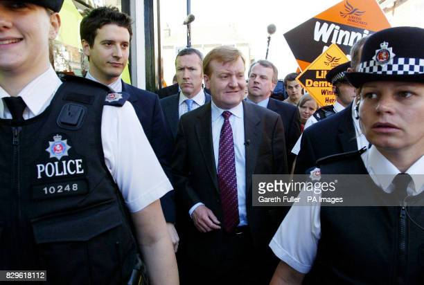 Liberal Democrat leader Charles Kennedy is flanked by police officers on the day the party pledged to offer fair solutions to real problems