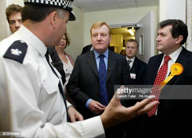 Liberal Democrat leader Charles Kennedy talks to Superintendent Charles Griggs during a tour around Orpington Police Station in Kent with prospective...