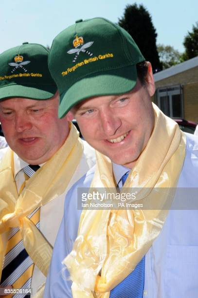 Liberal Democrat leader Nick Clegg and local party spokesman and Gurkha rights campaigner Peter Carroll are presented with hats and traditional...