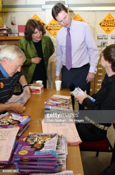 Liberal Democrat Leader Nick Clegg chats to campaign staff as they carry out paperwork at the Party's Norwich HQ ahead of the Norwich North...