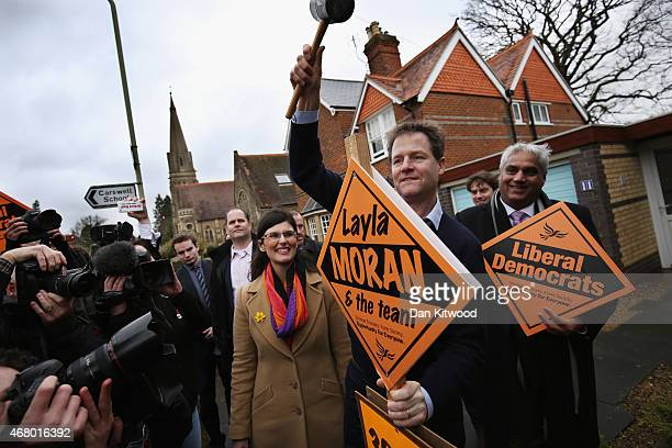 Liberal Democrat leader Nick Clegg hammers in the 300th Lib Dem stake board as Oxford West and Abingdon Layla Moran looks on after speaking to...