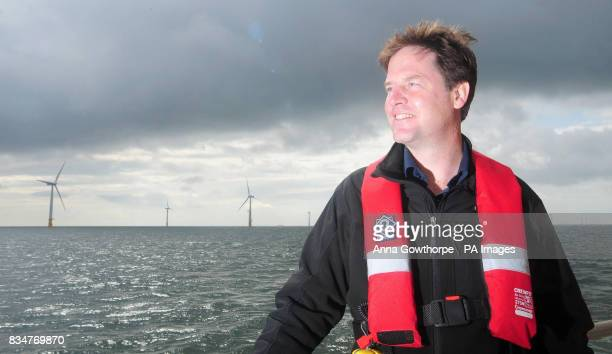 Liberal Democrat leader Nick Clegg looks out over the turbines of the Inner Dowsing offshore wind farm in the North Sea
