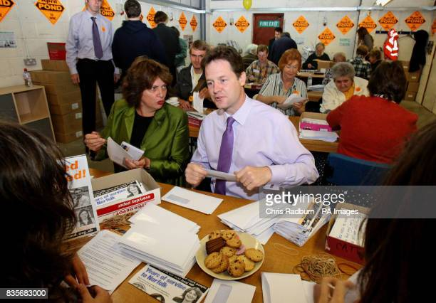 Liberal Democrat Leader Nick Clegg sits next to Norwich North byelection candidate April Pond as they carry out paperwork at the Party's Norwich HQ...